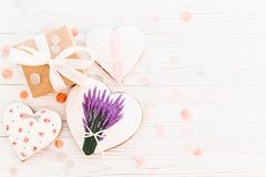 Happy mother`s day greeting card. cookie heart with lavender flo. Wers and craft gift box on white rustic wood background  flat lay. space for text. happy Stock Images