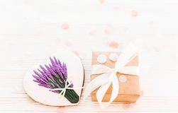 Happy mother`s day greeting card. cookie heart with lavender flo. Wers and craft gift box on white rustic wood background  flat lay. space for text. happy Royalty Free Stock Photo