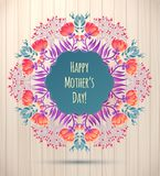 Happy Mother's Day greeting Card. Floral Wreath on Wood Background Stock Images