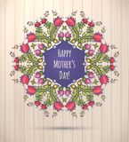 Happy Mother's Day greeting Card. Floral Wreath Wood Background Stock Photo
