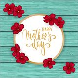 Happy mother s day greeting card with flowers red daisy on blue wooden table. Hand drawn brush pen lettering. design holiday greet Royalty Free Stock Photo