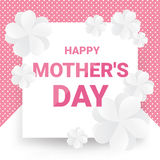 Happy mother`s day greeting card - Pink text with white paper flowers on pink dot pattern and white background. Royalty Free Stock Photography