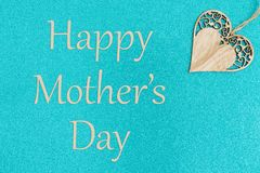Happy Mother`s day greeting card with wood heart