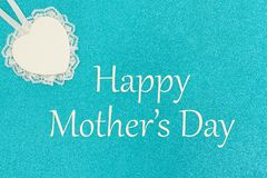 Happy Mother`s day greeting card with wood heart with lace