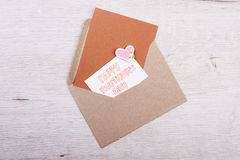 Happy Mother`s Day greeting letter. Bright heart on paper card. Festive mood for whole family. Precious moments for mom Stock Photography