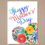 Happy mother's day hand-drawn lettering. Happy Mothers Day Typographical Background With Spring Flowers Stock Photo