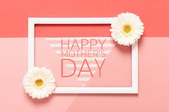 Happy Mother`s Day Living Coral Pantone Color Background. Flat lay mock up greeting card with beautiful gerbera flowers. Happy Mother`s Day Living Coral Pantone stock photography
