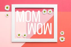 Happy Mother`s Day Living Coral and Pastel Pink Background. Floral flat lay minimalism greeting card. Happy Mother`s Day Living Coral and Pastel Pink Background stock photo