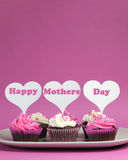 Happy Mother's Day message on pink and white decorated cupcakes - vertical with copy space Royalty Free Stock Photos