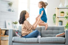 Mother and daughter playing. Happy mother`s day! Mom and her daughter child girl are playing, smiling and hugging. Family holiday and togetherness royalty free stock images
