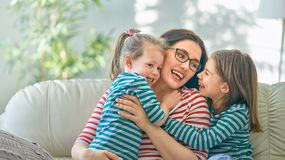 Mother and daughters playing stock photos