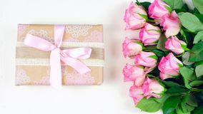Mother`s Day overhead with gift and pink roses on white wood table background Stock Photo