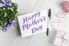 Happy Mother`s Day postcard. On white marble table stock photos