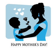Happy Mother's Day!. Silhouette of mother and child on a blue background with hearts. Boy gives a flower mom and mom hugs baby Stock Photo