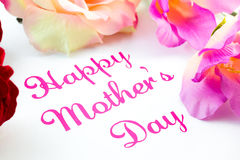 Happy mothers day text. Beetween flowers stock images