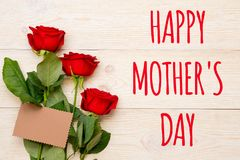 Happy mother`s day, red roses and craft paper card. Happy mother`s day, text with red roses and craft paper card Stock Image