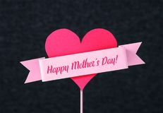 Happy Mother`s day text on a ribbon around a heart. Stock Photo