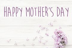 Happy mother`s day text sign. greeting card. gentle pink lilac f. Lowers on white rustic wooden background. tender soft image. mothers day concept. flat lay stock image