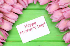 Happy mother's day with tulips flowers and greeting card Royalty Free Stock Photos
