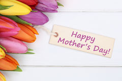 Happy mother's day with tulips flowers on wooden board Royalty Free Stock Image