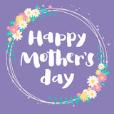 Happy mother's day violet floral card. Happy mother's day lettering card. Floral circle frame on light violet background. Hand written brush letters Royalty Free Stock Images