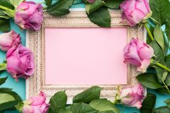 Happy Mother`s Day, Women`s Day or Birthday Flat Lay Background. Beautiful wooden vintage picture frame, fresh pink roses. Happy Mother`s Day, Women`s Day Royalty Free Stock Images
