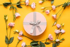Happy Mother`s Day, Women`s Day, Valentine`s Day or Birthday Yellow and Pastel Pink Colored Background. Flat lay greeting card. stock photography