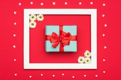 Happy Mother`s Day, Women`s Day, Valentine`s Day or Birthday Pastel Candy Colours Background. Red floral flat lay with present. Royalty Free Stock Photography