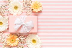 Happy Mother`s Day, Women`s Day, Valentine`s Day or Birthday Pastel Pink Background. Floral greeting card with beautiful present.