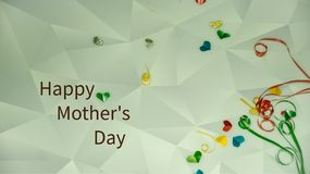 Happy Mother`s Day words with small colorful heart shaped and gift boxes as background. royalty free stock images