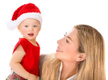 Happy mother with Santa girl Royalty Free Stock Photography