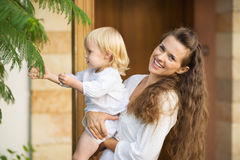Happy mother showing baby plants outdoors Royalty Free Stock Photos