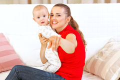 Happy mother showing something to her baby Stock Image