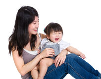 Happy mother siitng with baby daughter Royalty Free Stock Image