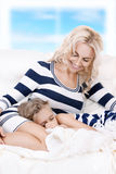 Happy mother and sleeping girl Stock Photography