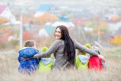Happy mother with small children walking Stock Images