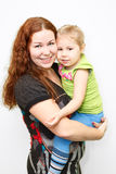 Happy mother and small daughter on hands Royalty Free Stock Photography