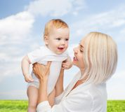 Happy mother with smiling baby Royalty Free Stock Photography
