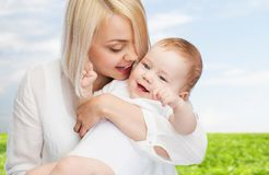 Happy mother with smiling baby Stock Image