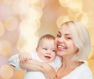 Happy mother with smiling baby Stock Photos