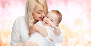 Happy mother with smiling baby Stock Images