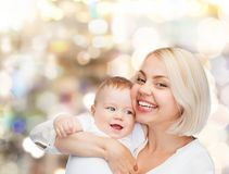 Happy mother with smiling baby Royalty Free Stock Photos