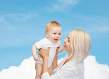 Happy mother with smiling baby Royalty Free Stock Images