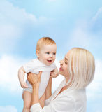 Happy mother with smiling baby Royalty Free Stock Image