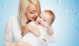 Happy mother with smiling baby Stock Photo
