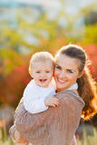Happy mother with smiling baby on street Royalty Free Stock Image