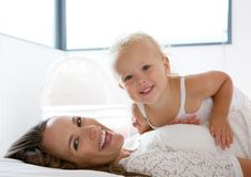 Happy mother smiling with cute little girl Stock Photography