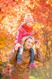Happy mother and and smiling kid together outdoor in autumn Stock Photo