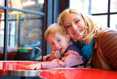 Happy mother and son. In a Parisian cafe Stock Image