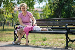 Happy mother and son on the bench in a park Stock Image